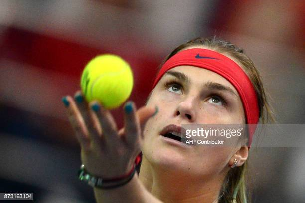 Belarus' Aryna Sabalenka serves the ball to USA's Coco Vandeweghe on November 12 2017 in Minsk during their Fed Cup final tennis match between...