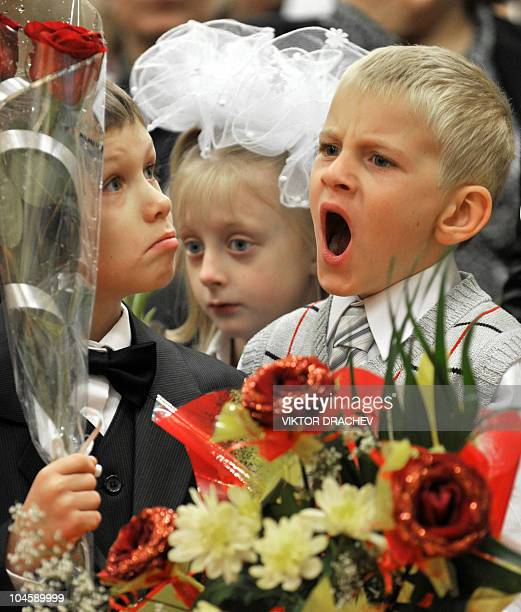 A Belarus boy yawns during a first bell ceremony to mark the beginning of the school year in Minsk on September 1 2010 According to tradition the...
