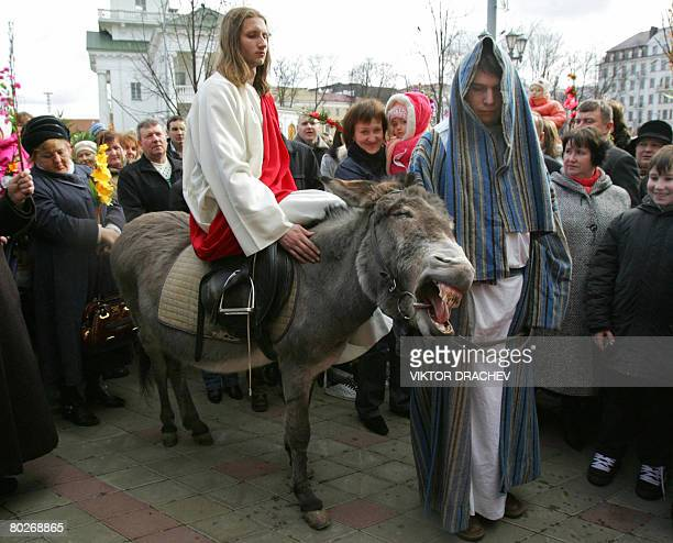 Belarus Catholics celebrate the Palm Sunday religious holiday near a cathedral in Minsk on March 16 2008 Palm Sunday is celebrated a week before...