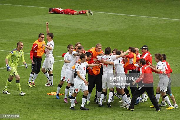 Belarus celebrate their 10 victory at the final whistle during the UEFA European Under21 Championship 3rd/4th Play Off match between Belarus and...