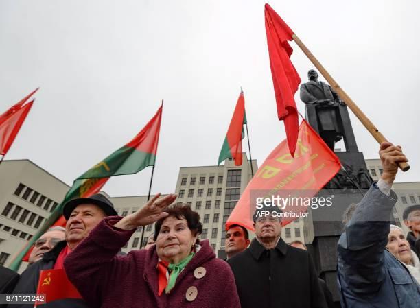 Belarus' Communist supporters gather in front of the Soviet Union founder Vladimir Lenin monument in Minsk on November 7 to celebrate the 100th...