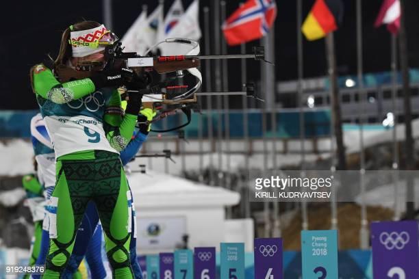 TOPSHOT Belarus' Darya Domracheva competes at the shooting range during the women's 125km mass start biathlon event during the Pyeongchang 2018...