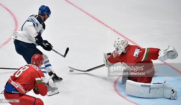 Belarus' defender Ilya Shinkevich a tries to stop Finland's forward Aleksander Barkovattacking the net of Belarus' goalie Vitali Koval during the...