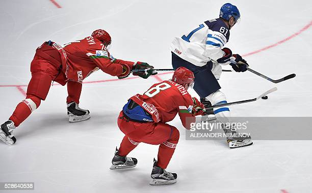 Belarus' defender Ilya Shinkevich and Belarus' forward Sergei Kostitsyn tries to stop Finland's forward Aleksander Barkov during the group B...