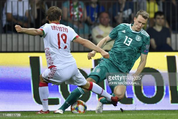 Belarus' defender Maksim Valadzko and Germany's defender Lukas Klostermann vie for the ball during the Euro 2020 football qualification match between...