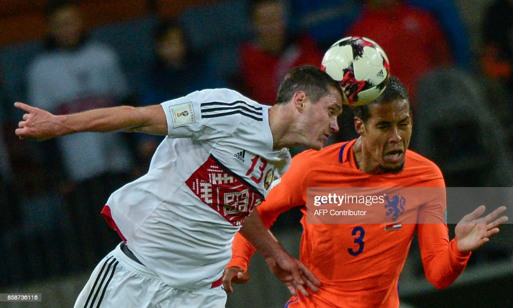 Belarus' forward Nikolai Signevich and The Netherlands' Virgil Van Dijk vie for the ball during the FIFA World Cup 2018 qualification football match between Belarus and the Netherlands in Borisov, outside Minsk, on October 7, 2017. /