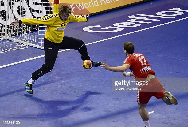 Belarus' goalkeeper Kazimir Kotlinski tries to stop a shot by Croatia's left wing Lovo Sprem during the 23rd Men's Handball World Championships round...