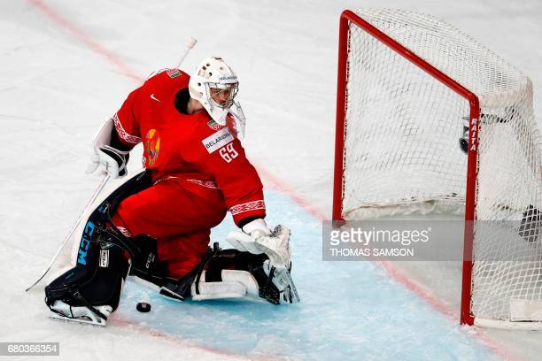 Belarus' goalkeeper Mikhail Karnaukhov misses the puck during the IIHF Men's World Championship group B ice hockey match between Belarus and Canada...