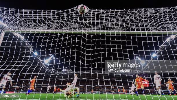 Belarus' goalkeeper Sergei Chernik fails to stop the ball during the FIFA World Cup 2018 qualification football match between Belarus and the...