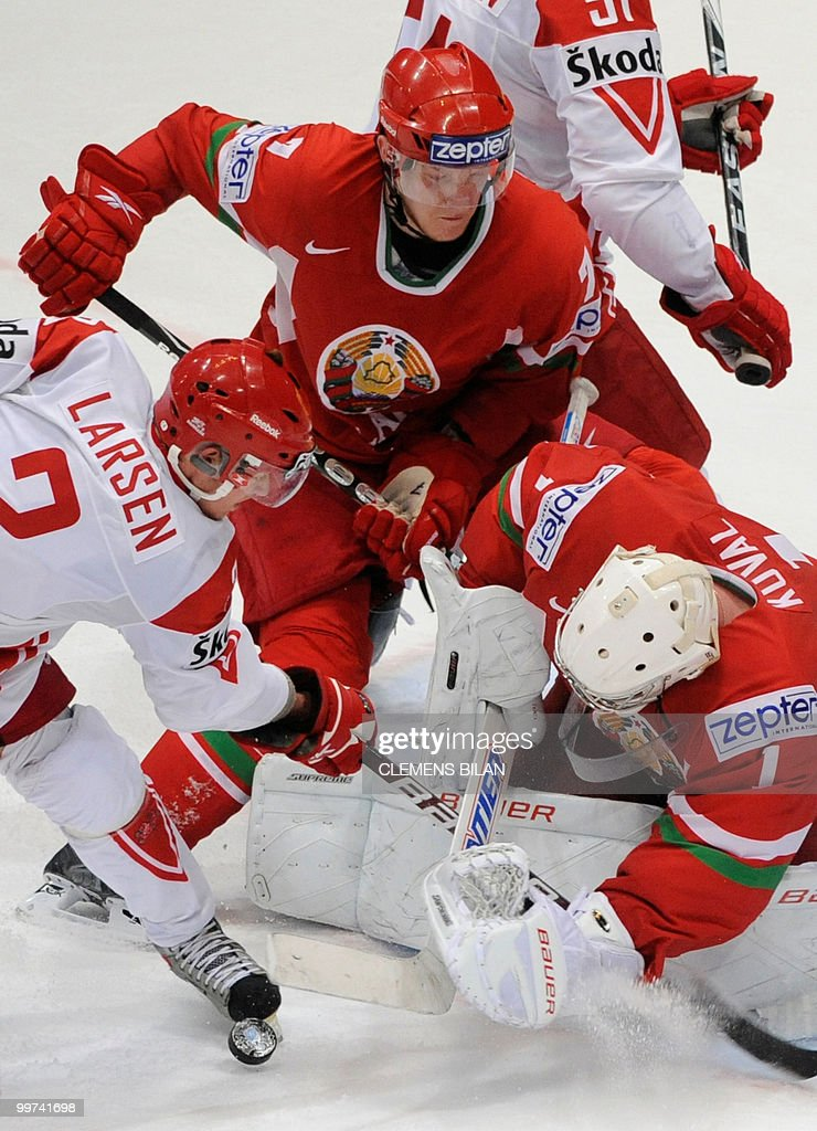 Belarus' goalkeeper Vitali Koval (R) and Denmark's Philip Larsen (L) vie during the IIHF Ice Hockey World Championship match Belarus vs Denmark in the western German city of Cologne on May 17, 2010. The 2010 IIHF Ice Hockey World Championships are taking place in Germany from May 7 to 23, 2010.