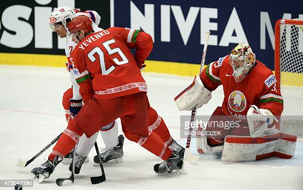Belarus goalkeeper Vitali Koval looks on his teammate Oleg Yevenko fighting for the puck with Andreas Martinsen of Norway during the group B...
