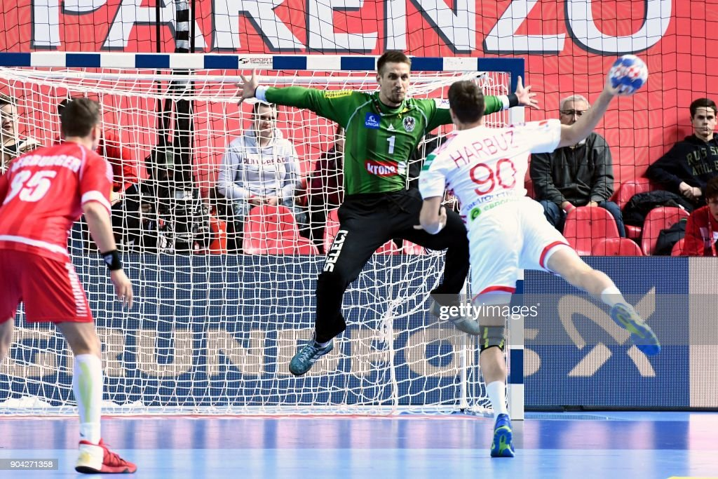 Belarus' Hleb Harbuz (R) shoots the ball in front of Austria's goalkeeper Thomas Bauer during the preliminary round group B match of the Men's 2018 EHF European Handball Championship between Belarus and Austria in Porec, Croatia on January 12, 2018. /