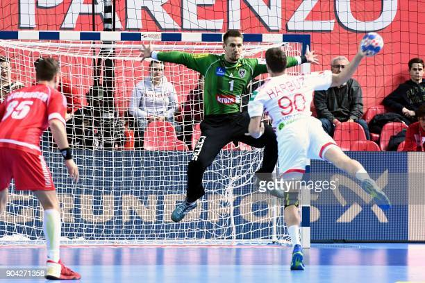 Belarus' Hleb Harbuz shoots the ball in front of Austria's goalkeeper Thomas Bauer during the preliminary round group B match of the Men's 2018 EHF...