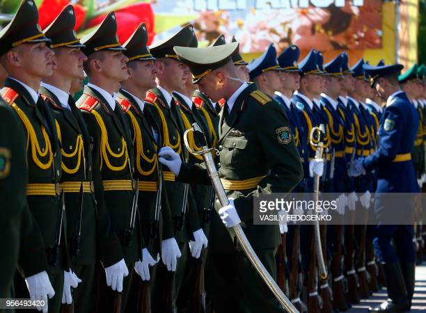TOPSHOT Belarus' honour guards prepare themselves prior to a wreath laying ceremony marking the 73rd anniversary of the victory over Nazi Germany in...