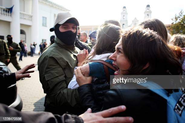 Belarus law enforcement officers altercate with protesters during a rally to protest against the presidential election results in Minsk on September...
