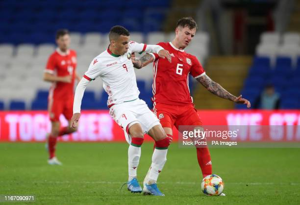 Belarus' Max Ebong and Wales' Joe Rodon battle for the ball during the International Friendly match at Cardiff City Stadium Cardiff Wales