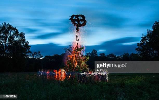 Belarus men and women dance around a bonfire in the countryside near the village in the Kulneva some 280 km north the capital Minsk early on June 24...