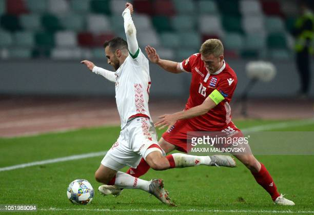 Belarus' midfielder Igor Stasevich vies with Luxembourg's defender Laurent Jans during the UEFA Nations League football match between Belarus and...