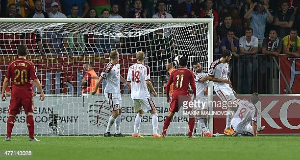 Belarus' midfielder Sergei Kislyak fails to stop the ball during the Euro 2016 group C qualifying football match between Belarus and Spain in Borisov...