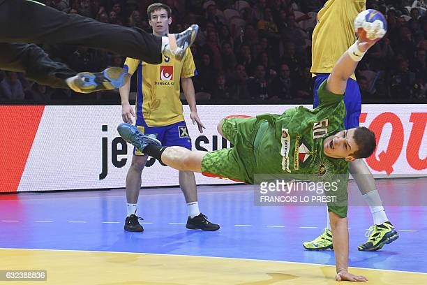 Belarus' pivot Artsem Karalek shoots on goal as Sweden's goalkeeper Andreas Palicka stretches out during the 25th IHF Men's World Championship 2017...