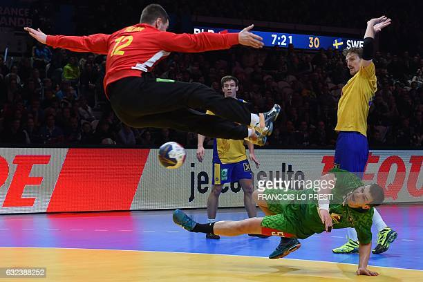 Belarus' pivot Artsem Karalek shoots on goal under Sweden's goalkeeper Andreas Palicka during the 25th IHF Men's World Championship 2017 eighth final...