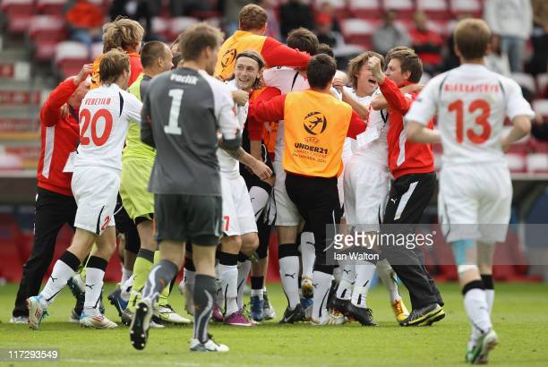 Belarus players celebrate winning the UEFA European U21 Championship third place playoff match between Czech Republic and Belarus at the Aalborg...