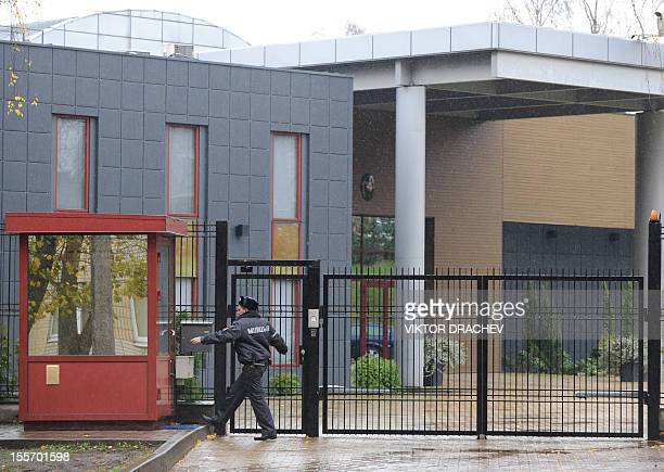 A Belarus police officer enters his booth at an entrance to the Lithuania's Embassy in Minsk on November 7 2012 Lithuania said today it would lodge a...