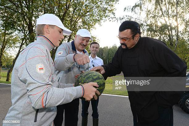 Belarus President Alexander Lukashenko and his son Nikolai hand over a watermelon to US actor Steven Seagal who has been recenlty granted Serbian...