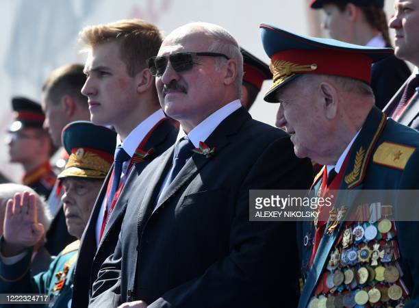 Belarus President Alexander Lukashenko and his son Nikolai watch a military parade, which marks the 75th anniversary of the Soviet victory over Nazi...