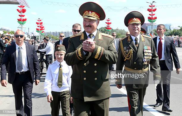 Belarus President Alexander Lukashenko and his son Nikolay attend Independence Day parade in Minsk, on July 3, 2013. Belarus celebrated today...