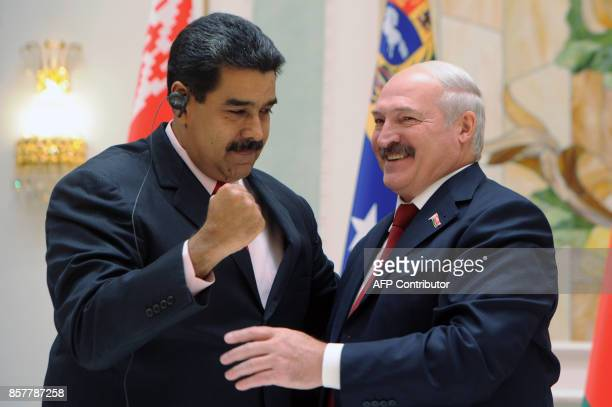 Belarus' President Alexander Lukashenko and his Venezuelan counterpart Nicolas Maduro react during a joint press conference following their meeting...