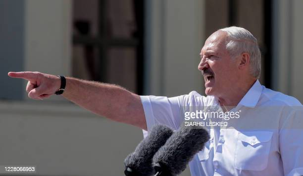 Belarus' President Alexander Lukashenko gestures as he delivers a speech during a rally held to support him in central Minsk, on August 16, 2020. -...
