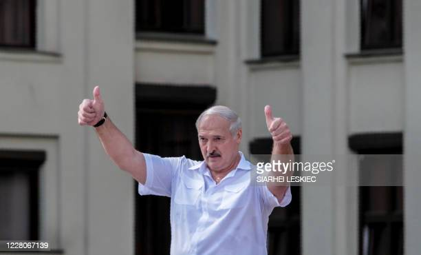 Belarus' President Alexander Lukashenko gestures during a rally held to support him in central Minsk, on August 16, 2020. - The Belarusian strongman,...