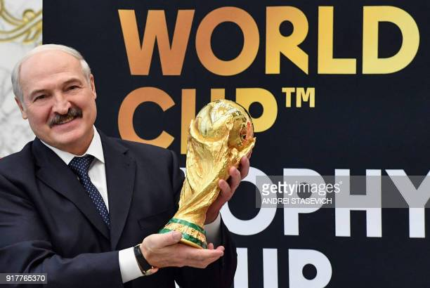 Belarus President Alexander Lukashenko holds the FIFA World Cup trophy during a ceremony in Minsk on February 13 2018 The FIFA World Cup Trophy Tour...