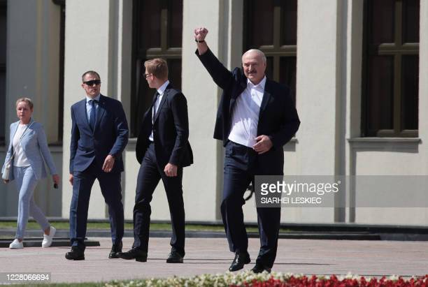 Belarus' President Alexander Lukashenko raises his fist up as he arrives to a rally held to support him in central Minsk, on August 16, 2020. - The...