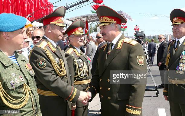 Belarus President Alexander Lukashenko shakes hands with the militaries after the Independence Day parade in Minsk, on July 3, 2013. Belarus...