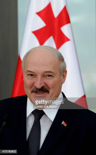 Belarus' President Alexander Lukashenko smiles during a joint press conference with his Georgian counterpart in Tbilisi on April 23 2015 Alexander...
