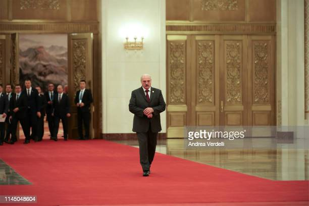 Belarus President Alexander Lukashenko walks towards Chinese President Xi Jinping for the handshake before the bilateral meeting of the Second Belt...
