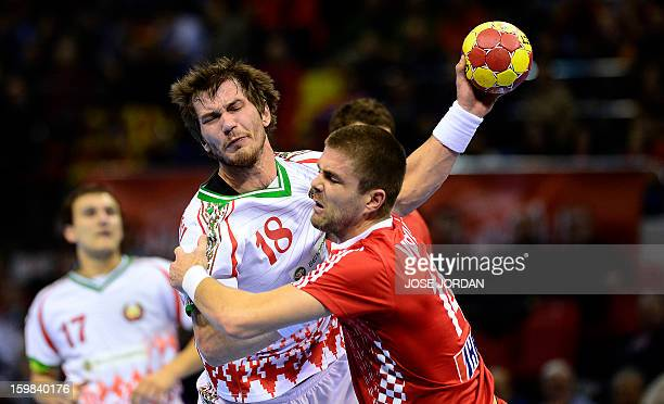 Belarus' right back Siarhei Shylovich vies with Croatia's left back Drago Vukovic during the 23rd Men's Handball World Championships round of 16...