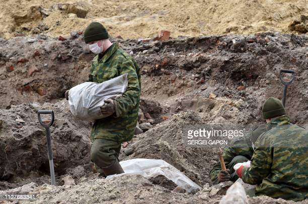 Belarus' servicemen excavate a mass grave for the prisoners of a Jewish ghetto set up by the Nazis during World War Two that was uncovered at a...