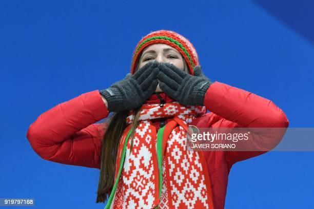 Belarus' silver medallist Darya Domracheva blows a kiss on the podium during the medal ceremony for the biathlon women's 12,5km mass start at the...