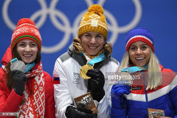 Belarus' silver medallist Darya Domracheva Slovakia's gold medallist Anastasiya Kuzmina and Norway's bronze medallist Tiril Eckhoff pose on the...