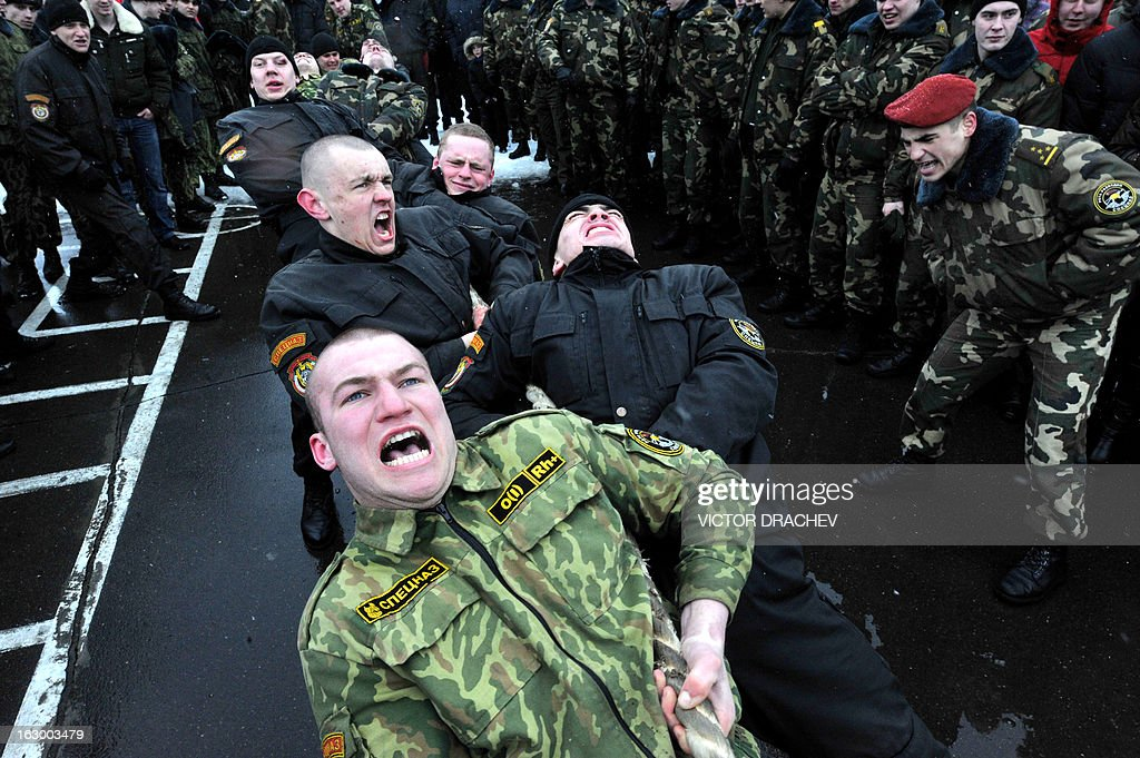 Belarus soldiers from an Interior Ministry special unit compete in a tug-of-war during a military show marking Maslenitsa holiday on the outskirts of Minsk on March 3, 2013. Maslenitsa is an medieval pagan festival that celebrates the end of winter and the start of spring.