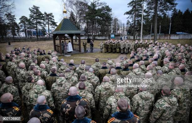 Belarus soldiers take part in an Orthodox service in a military base in Minsk on January 7 2018 Orthodox Christians celebrate Christmas on January 7...