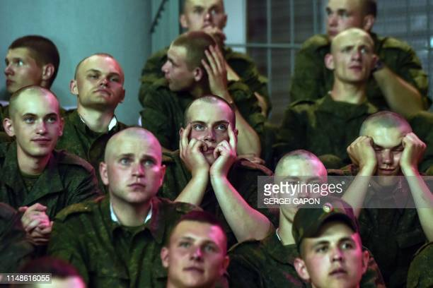 Belarus' soldiers watch the Euro 2020 football qualification match between Belarus and Germany in Borisov outside Minsk on June 8 2019