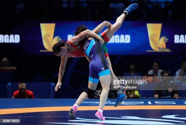 Belarus' Vanesa Kaladzinskaya competes with Japan's Mayu Mukaida during the women's freestyle wrestling 53kg category final of the FILA World...