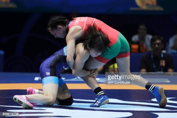 Belarus' Vanesa Kaladzinskaya competes with Japan's Mayu Mukaida during the women's freestyle wrestling 53kg category final of the FILA World...