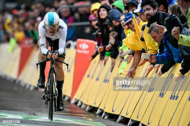 Belarus' Vasil Kiryienka reacts as he crosses the finish line during a 14 km individual time-trial, the first stage of the 104th edition of the Tour...