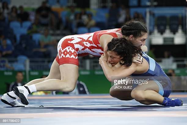 Belarus' Vasilisa Marzaliuk competes with France's Cynthia Vanessa Vescan during the women's wrestling 75kg qualifications at the Rio 2016 Olympic...