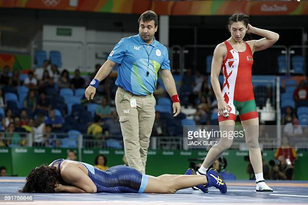 Belarus' Vasilisa Marzaliuk looks at France's Cynthia Vanessa Vescan reacting during the women's wrestling 75kg qualifications at the Rio 2016...